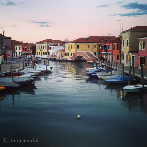 Murano at sunset: soccer ball on the water